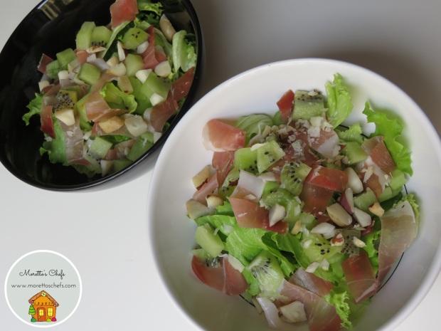 Insalata kiwi e speck con noci del Brasile e sedano croccante - ricetta per Vivere per raccontarla